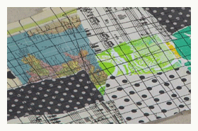 stitch a grid on the collages papers