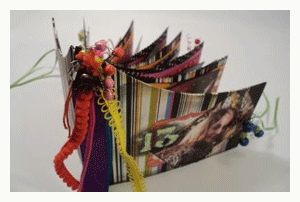 book binding with trims, beads, and found objects