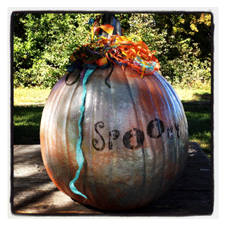 pumpkin decorated with metallic paints and art stencils