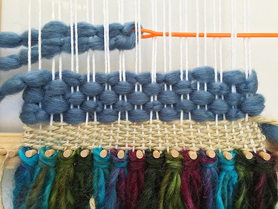 First rows of mixed-media weaving