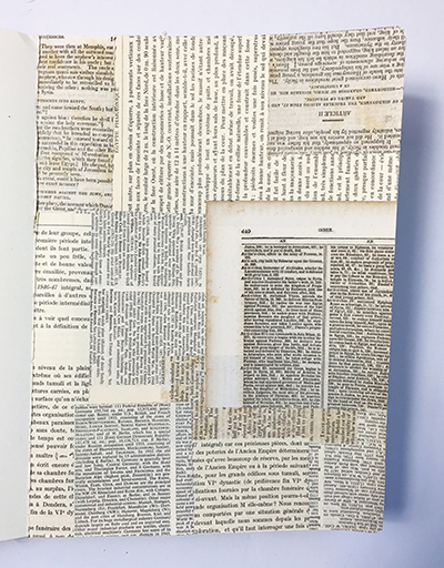 Visual texture created by gluing text pages to an art journal page