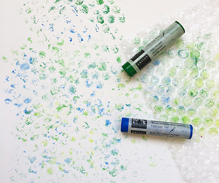 Wax pastel art supplies used with bubble wrap