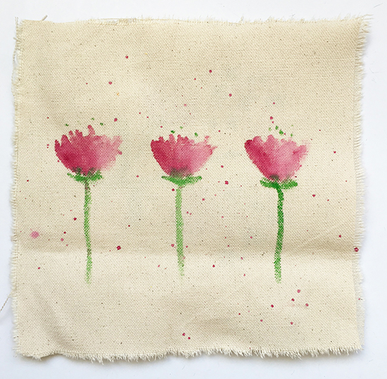 Wax pastel art supplies on fabric