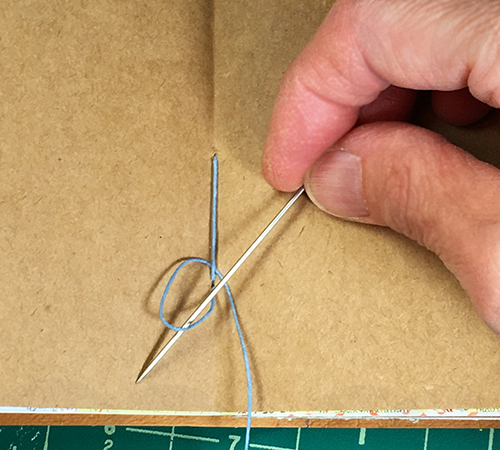 Knotting the thread