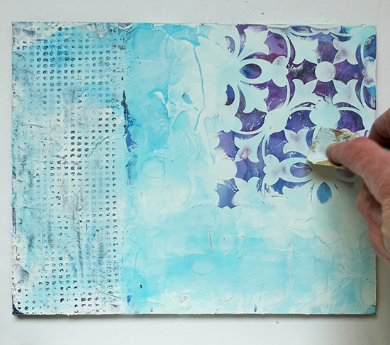 Sanding plaster to reveal stencil pattern