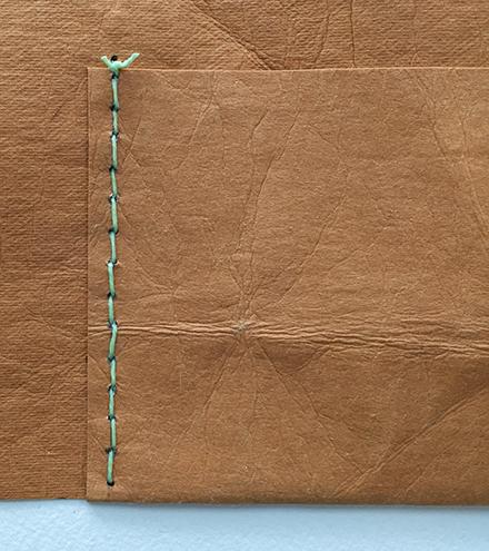 Pocket row stitched