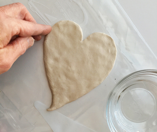 Smoothing paper clay with water.