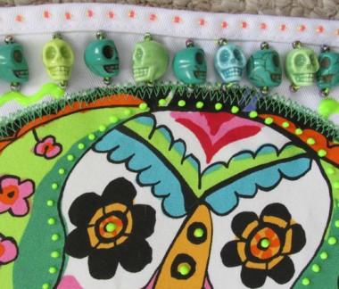 Sugar skulls apron (detail) | ClothPaperScissors.com