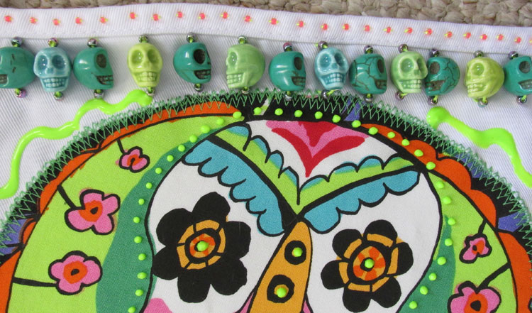 Sugar skulls apron (detail)   ClothPaperScissors.com