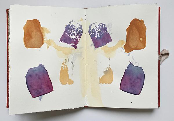 Tea bag marks in an art journal