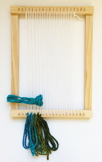 Attaching tassels to a weaving