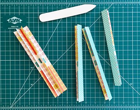Creating a binding bar for an envelope journal