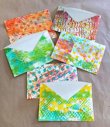 Plain envelopes printed with monoprints